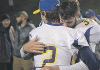 Ferndale's Sky Freeman (left) and Austin Honeycutt have an emotional hug after their season-ending loss to the powerful Bellevue Wolverines Saturday night. The Golden Eagles got back to the playoffs after a disappointing 2014 season. (Kevin Doucette/Ferndale Record)