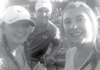 Jillian Anderson and Maeson Mullens, FHS students and golf team members, served as standard bearers at the Hyundai Tournament in Kapalua, Maui, in early January. They watched 32 PGA golfers including Jordan Spieth (center) throughout the four-day tournament. (Courtesy photo)